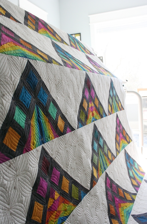 Maker:  Brenda  of  Eye Candy Quilts   Pattern:  Nene by Eye Candy Quilts   Pantograph:  Starlight by Karlee Porter Designs   Fabric:  Quantum by Giucy Giuce for Andover