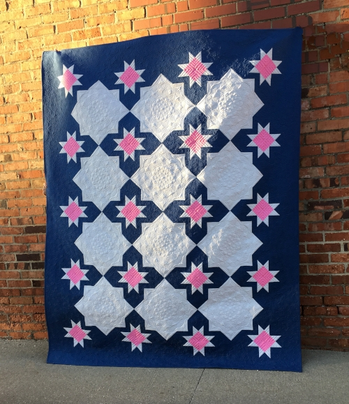 Maker:  Jessie Zeigler  (that's me and you are on my website!)  Pattern:  Cora by Jessie Zeigler of Threaded Quilting Studio   Custom quilted by me.