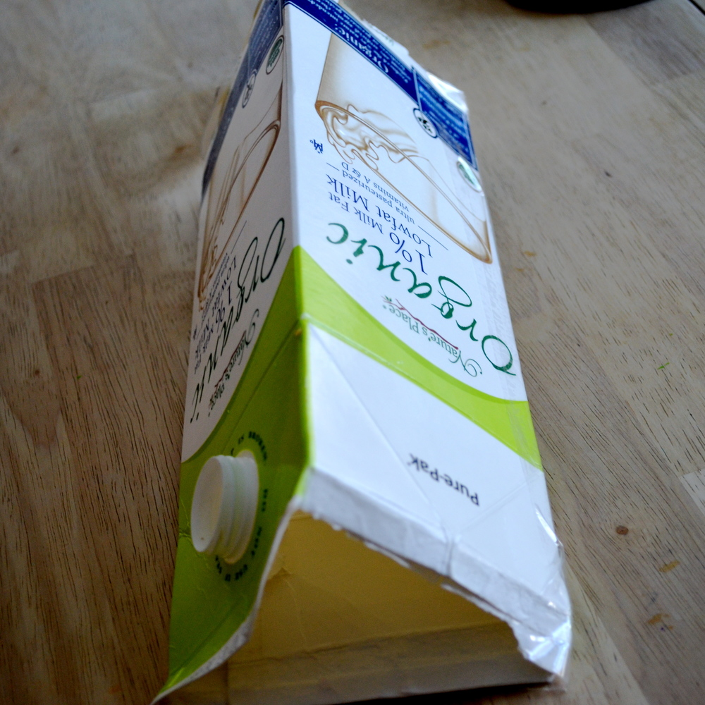 Behold: the milk carton is transformed into a triangle mold, with the help of its trusty friend, Packaging Tape.