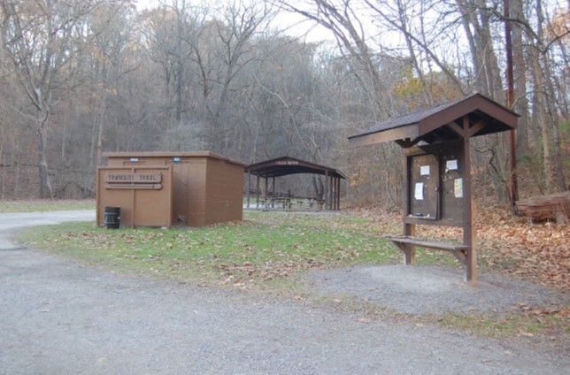 Rest room building, picnic shelter, and bulletin board at intersection of Tranquil, Falls Ravine, and Nine Mile Run Trails