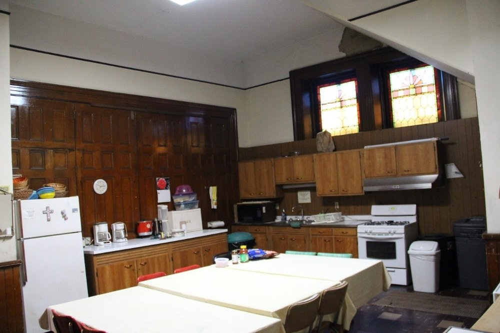 34 View southwest showing 1st floor west anteroom, now used as a kitchen.jpg