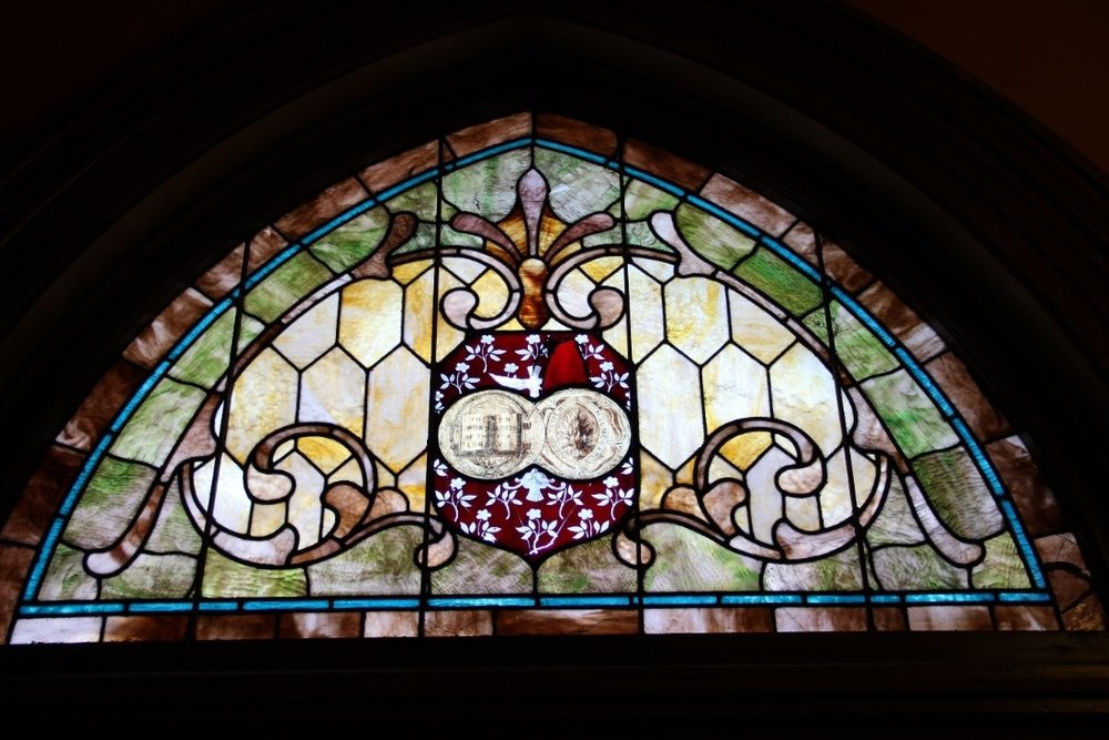 37 View facing north of interior of stained glass transom above west door.jpg