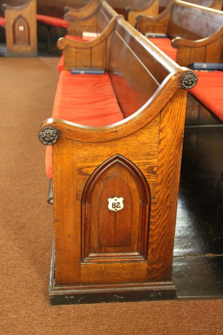 53 View west showing detail of pew #82.  The main body of the pew is solid white ash, while the scrolls, caps, panel trim are walnut.jpg