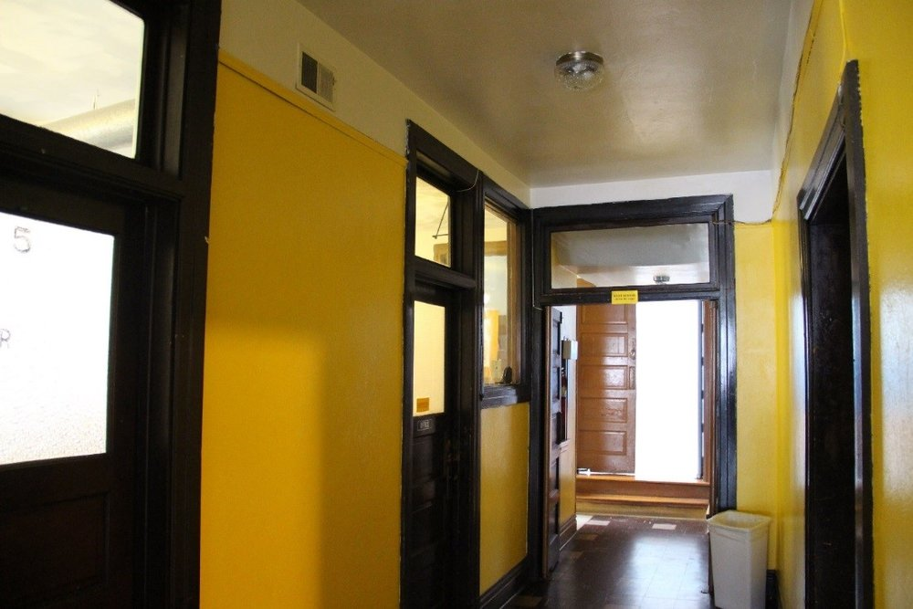 63 View west showing main 1st floor hallway of the 1913 community center.jpg
