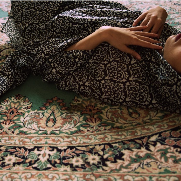 A woman and a Persian carpet