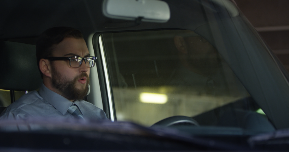 "A raw still from ""The Shift."" Kevin (Greg Tharpe) thinks about his terrible day."