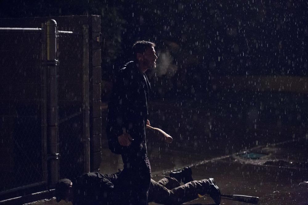 Brandon Quinn (Slugger) standing over Carlos Ragas (Thug 2) on a rainy, rainy night. Photo by PJ Barlow.