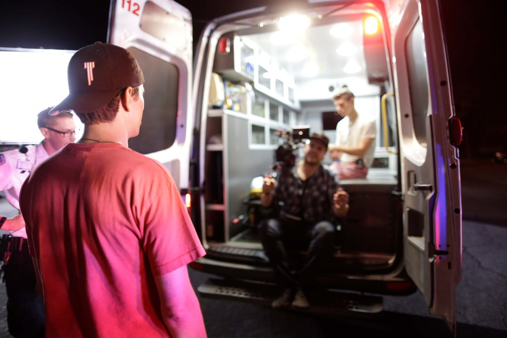 Director Travis Cluff readying a shot in an ambulance with a happy Director of Photography Kyle Gentz. The source of Kyle's happiness is still unknown, but is believed to be that morphine he found under the seats.