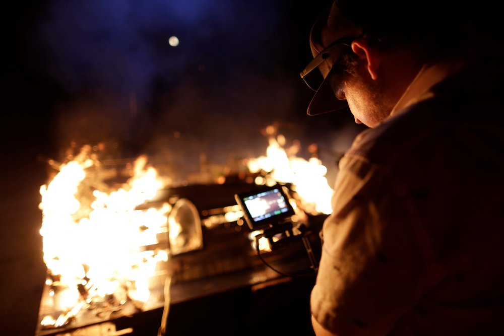 Director of Photography Kyle Gentz keeps the camera rolling as a miniature building goes up in flames. If you listen closely, you can hear the screams of the miniature people inside. (Editor's Note: no miniature people were harmed during the making of this film and the author of this blog is on notice for his tasteless attempts at humor.)