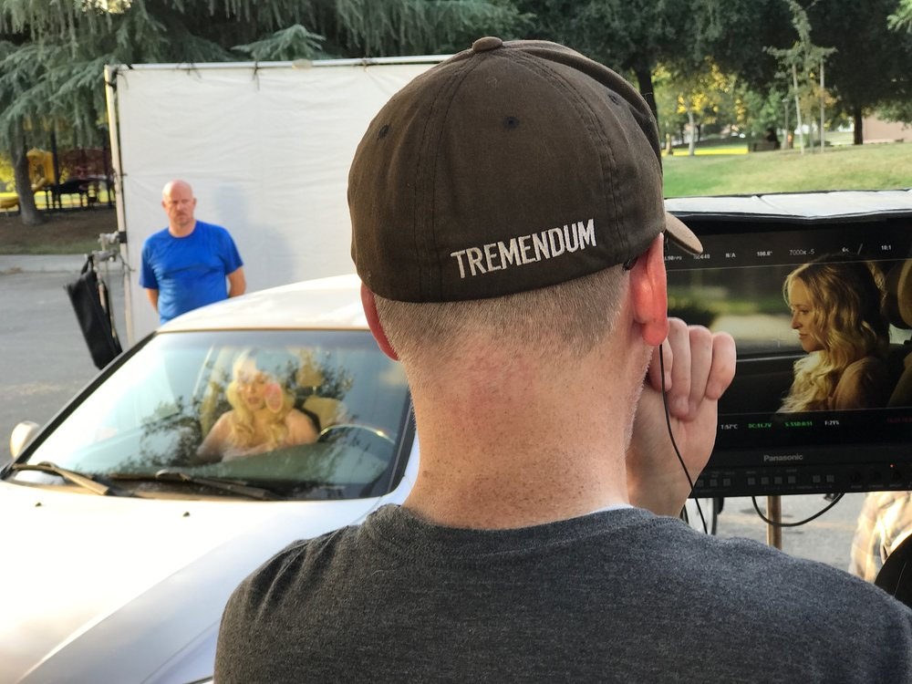 Me, looking over a shot of Audrey Neal (Cat Ryan) as Michael Needham (Coach Waller) looms nearby at the city park. This is the first time I'm getting a good look at the back of my neck, maybe ever. Dang, that's a lot of freckles. Photo Credit: Jenny Pauline-Mendoza