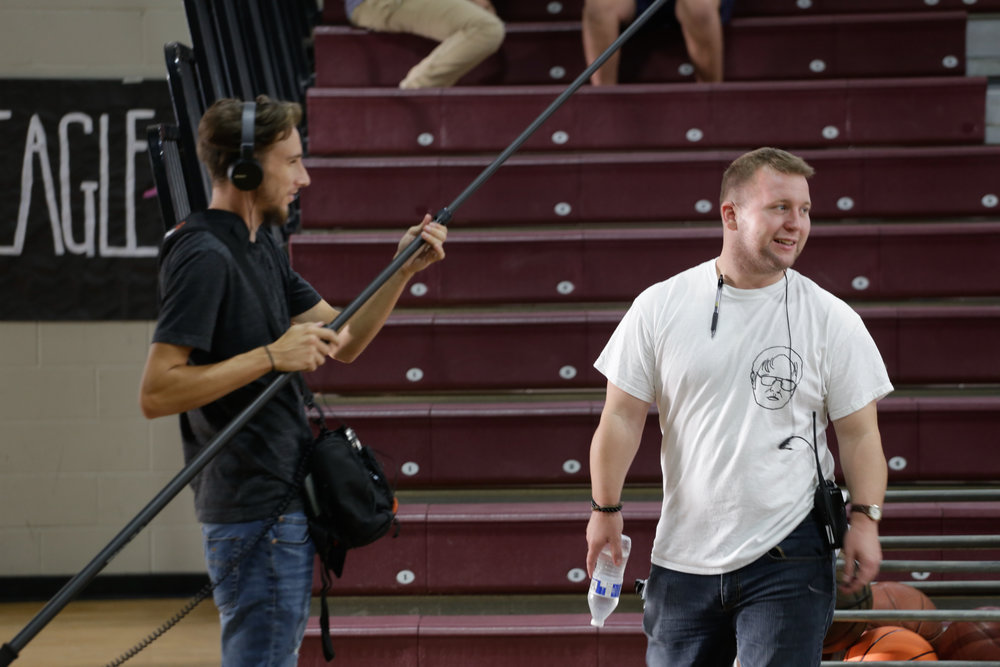 Sound Mixer Tyler Smith laughs with delight because he knows he's just seen a rare sight indeed: 1st Assistant Director Bear Dupras smiling. Photo Credit: Cody Allred