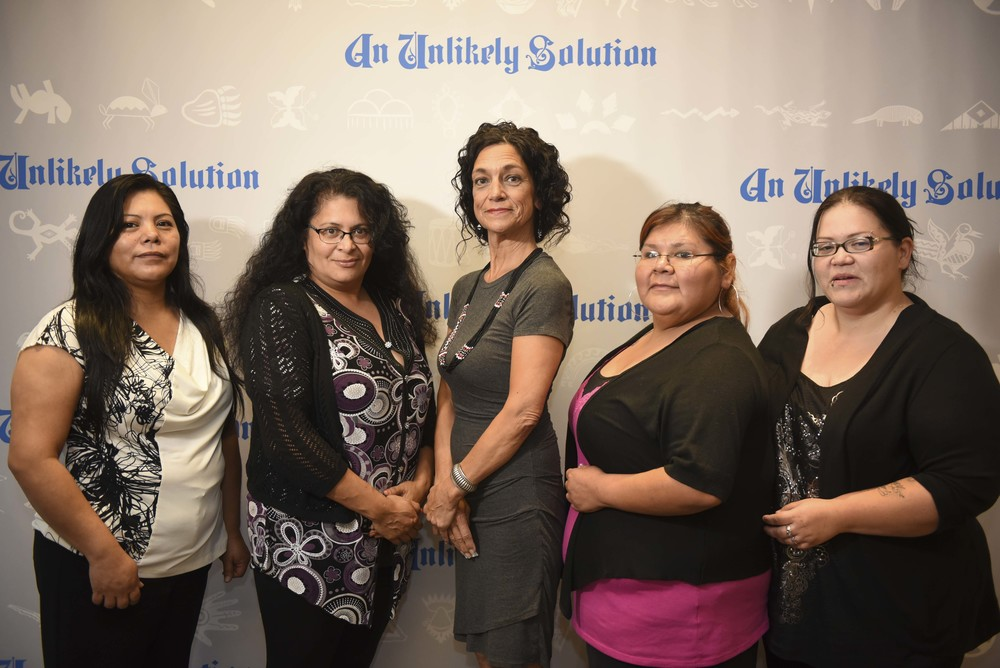 Sherry and friends closer in front of step and repeat.JPG