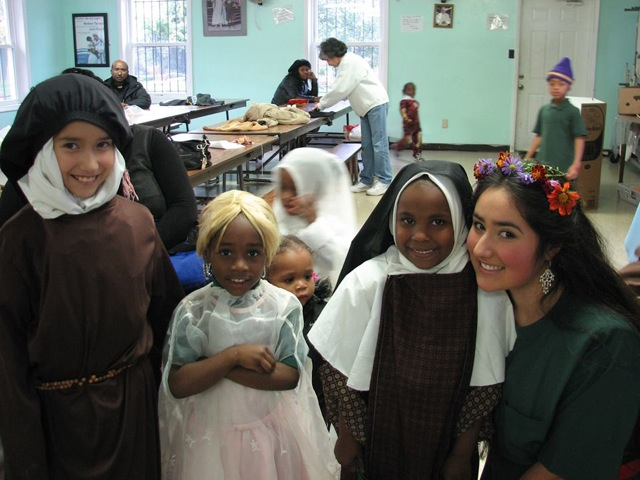 Chiara, (right) and her sister, Gemma, (far left) at The Missionaries Of Charity leading the children in songs on All Saints Day