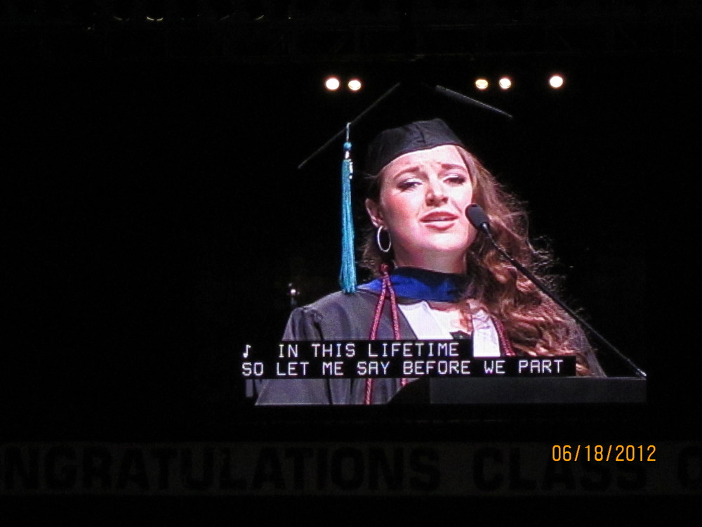 Malia sings @ Graduation - jumbotron.JPG