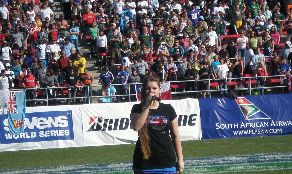 Malia sings for USA Sevens.JPG