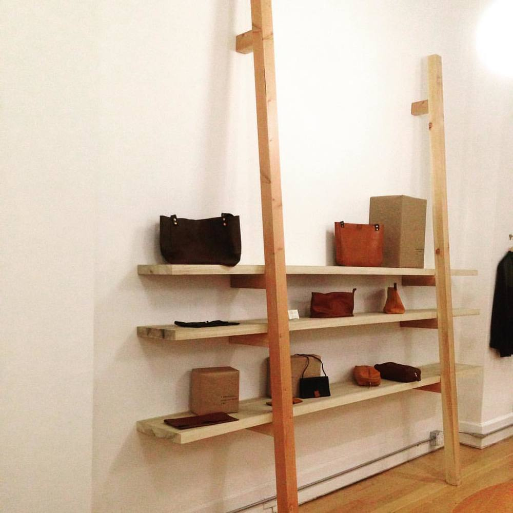 Loving our new shelves built by the Joseph & Steven Kerr! Adorned by @britthehunter Leather work #handcrafted #kosaarts #minimal #brassandblade  (at KOSA ARTS)