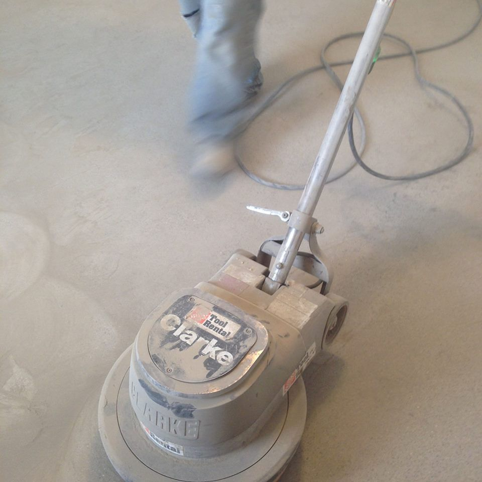 Finishing mezzanine floors at Kosa…it's sandy, but it's no beach.
