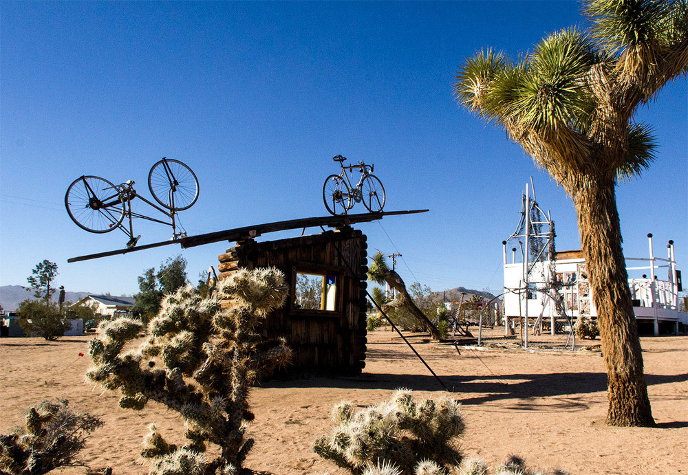 """ Purifoy dedicated himself to the found object, and to using art as a tool for social change. He lived the last 15 years of his life creating ten acres of large-scale sculpture on the desert floor. Constructed entirely from junked materials, this otherworldly environment is one of California's great art historical wonders."" -  Noah Purifoy Foundation"