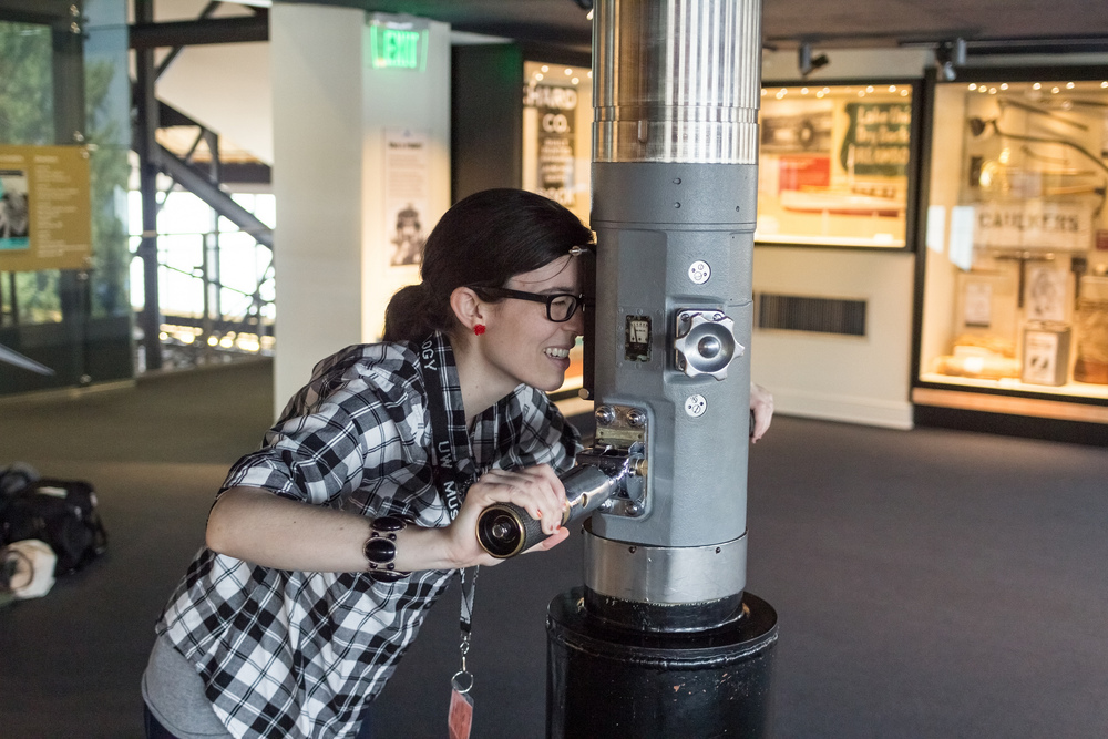 A student looks through the Periscope at MOHAI. Photo by  Dominic Arenas Photography .