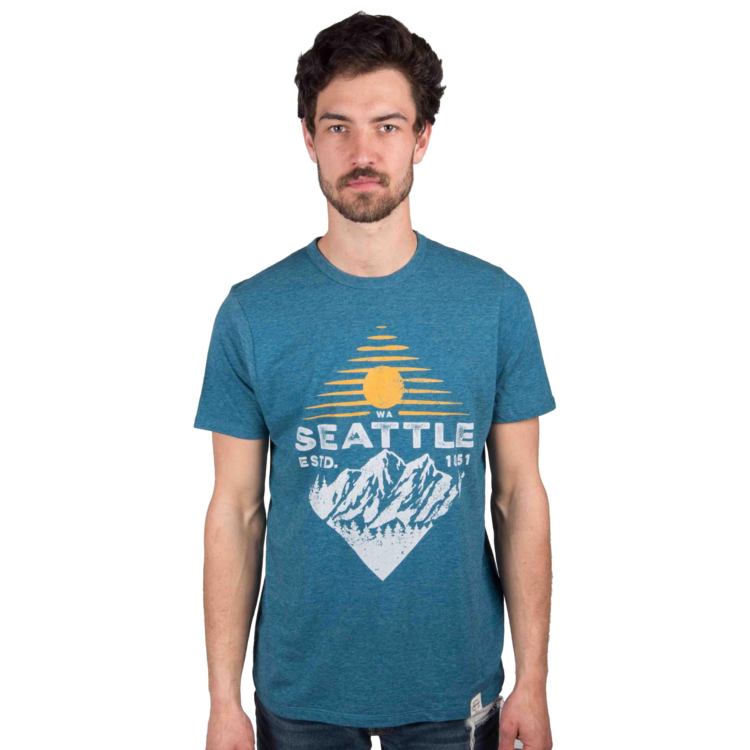 What's a Seattle Shirt company without an epic Seattle shirt with some mountains on it?! We couldn't tell you because we have no idea...all we know is that at Simply Seattle, we couldn't live with ourselves if we didn't have a mountainous Seattle shirt on deck. Grip the sunrise legacy tee to stay cool and look even cooler this spring!