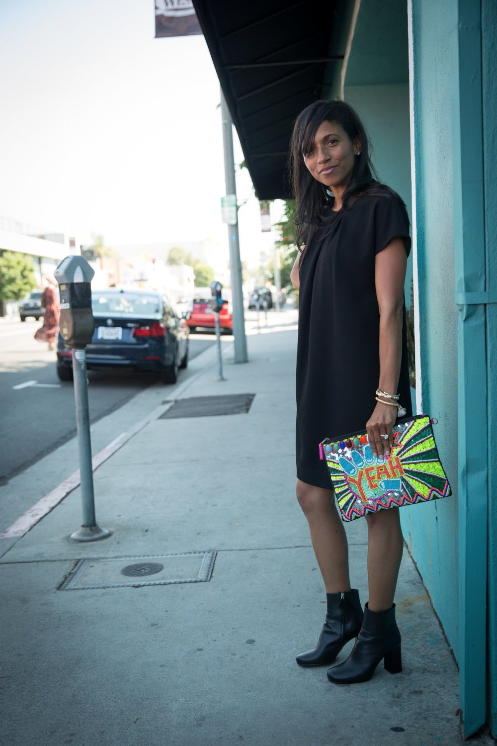 photo   Orit Harpaz  |   (fall weather in cali means no jacket needed for a few afternoon hours). this lbd has paid for itself ten times over. a classic silhouette paired with a cheeky clutch for an easy day look.