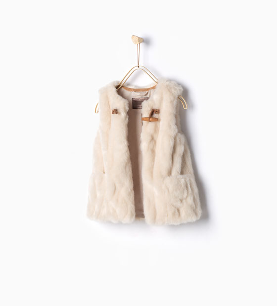 what girl wouldn't love this faux fur vest with toggle & pockets to wear with her go-to jeans? perfect for now and later. by zara kids. get it  here.