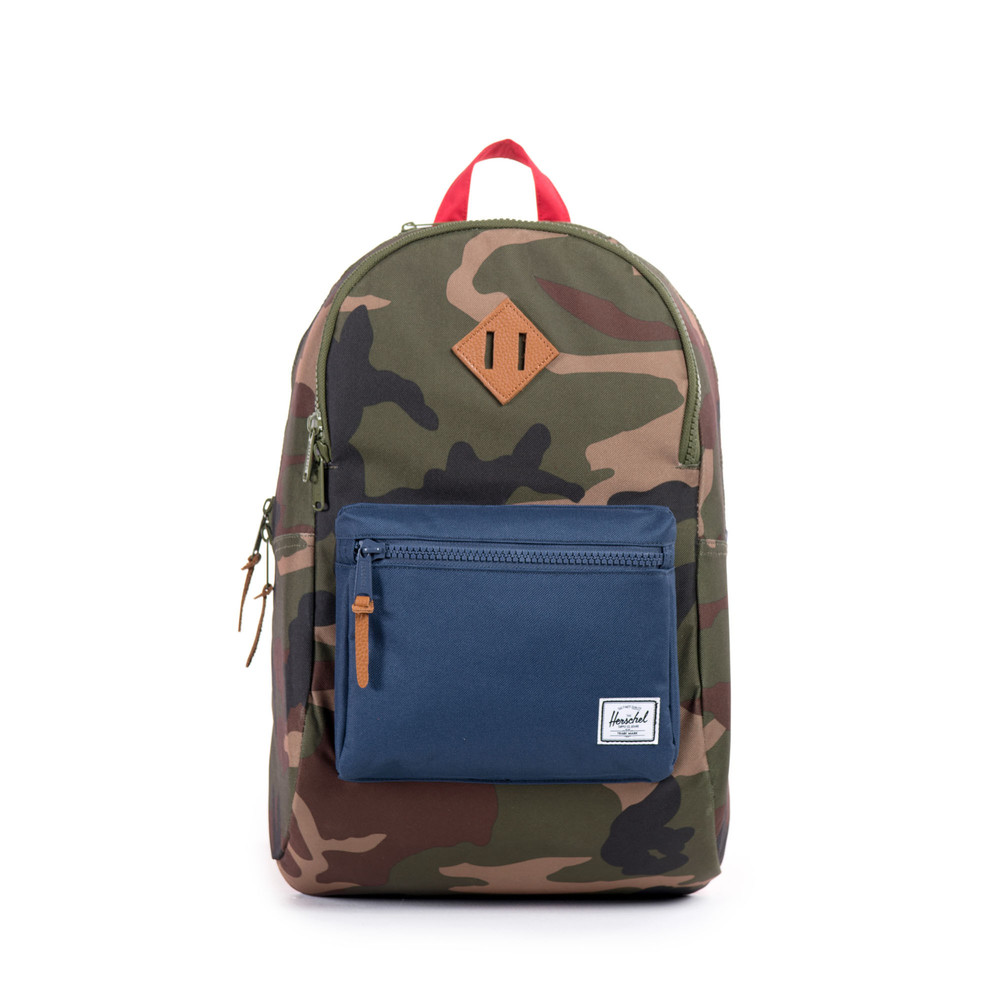 love this colorful (camo, navy, red!) backpack with tons of space for all their stuff by heritage brand herschel supply co. get it  here.
