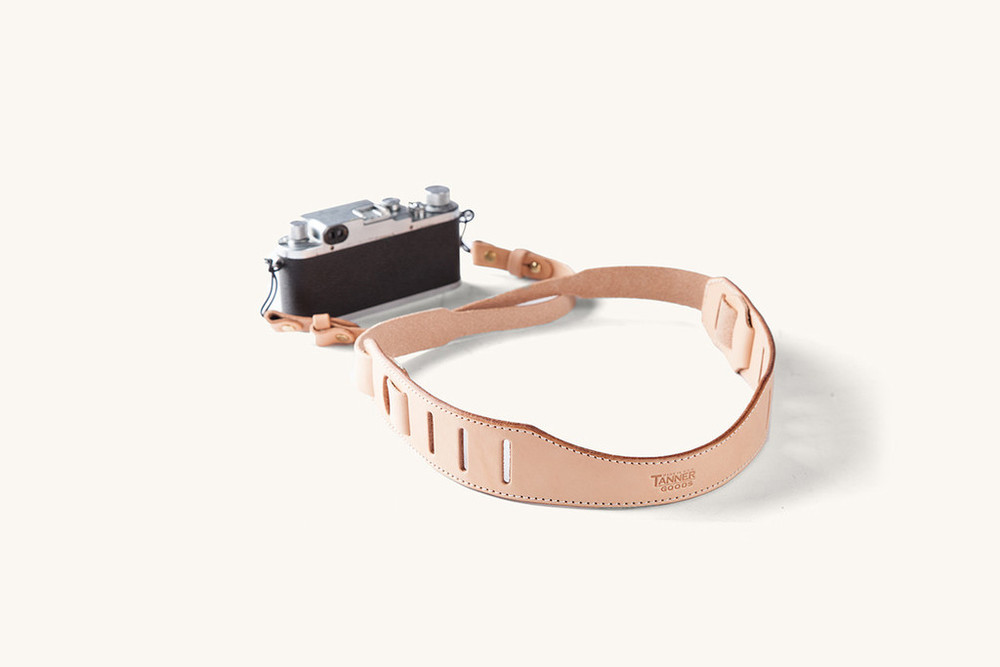 """it's the little things. this adjustable camera strap looks like a million and is made with """"tooling leather."""" doesn't that just sound important? by tanner goods. get it  here."""