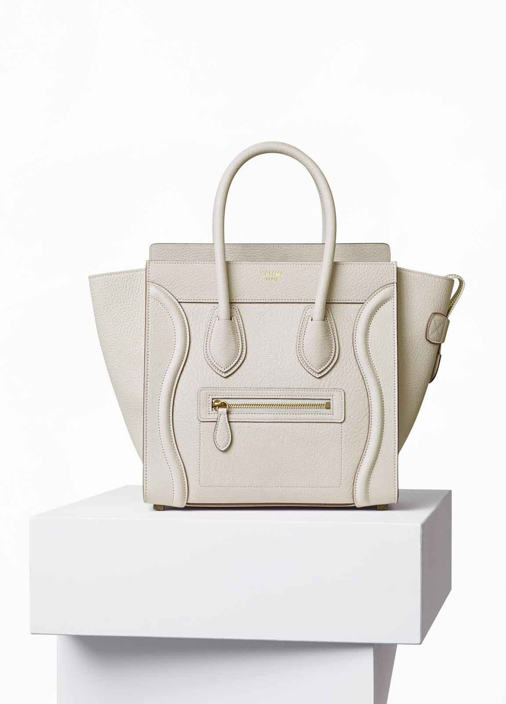 this bag is unbelievably gorgeous, crazy expensive and super impractical. seriously? white bag with kids? but that doesn't stop me from wanting it. school won't mind if i skip tuition for a bit, right? celine phantom bag. get it  here.
