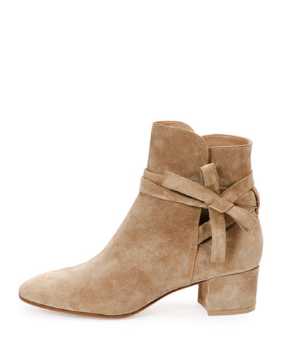 love. these. boots. totally doable height for mommy, amazing go-with-everything color, and perfect combo of tough (suede) and tender (bow). of course, there is the small matter regarding price. by my favorite, favorite shoes designer right now: gianvito rossi. get them  here.