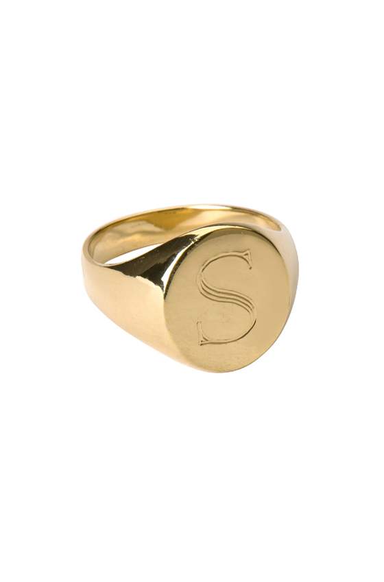 in historical times, signet rings would be pressed into hot wax or soft clay, and used as an identification mark proving autheticity. today, they're just pretty. but i think they make for a lovely heirloom piece. this one is by letters by zoe and you can get it  here  in several metals.