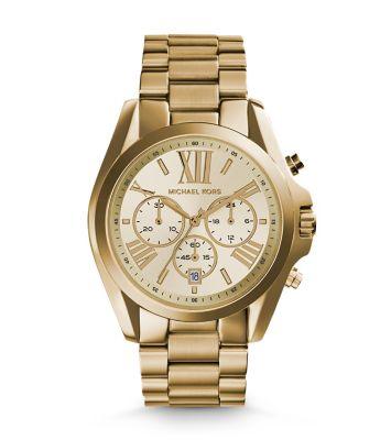 this chunky gold watch will not go unnoticed. you could wear it alone or stacked with bangles. this one is no-fail. by michael kors. get it at nordstrom  here.
