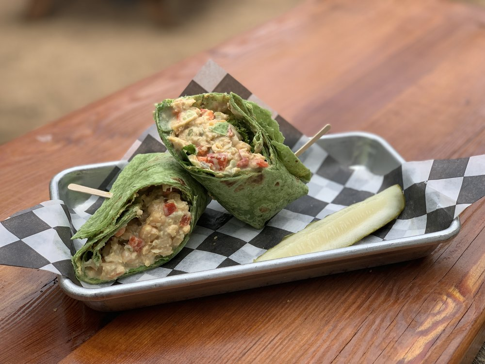 The Hippy Hollow - Vegan chickpea sandwich on a spinach wrap