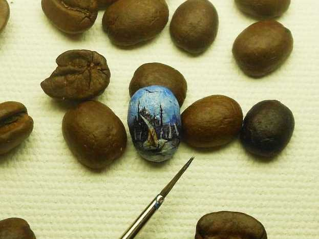 Hasan Kale's tiny paintings on coffee beans.