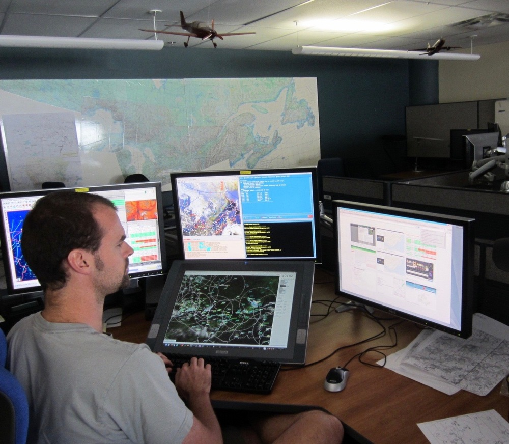 Forecaster working on your aviation forecasts in the Canadian Meteorological Aviation Centre in downtown Montreal.
