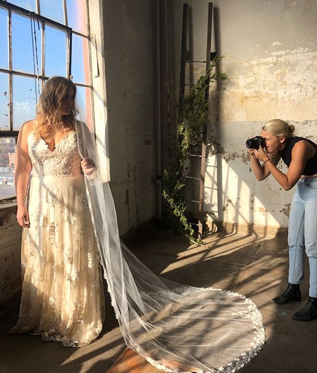 A little behind the scenes of a shoot we did in the fall with @wildescoutphoto.co in #Bushwick Brooklyn with the gorgeous @plusmodelkrista 😍 How gorgeous is that Juniper gown in the sunset?  Did you know we carry samples in sizes 6, 10, and 18 (and a few up to 22)? And all our @rebeccaschoneveld_bridal gowns can be made in sizes 00-30 (with no price differences between the sizes!). Our goal is to make every bride feel more gorgeous than she's ever felt and this is just one of the (pretty basic) ways we've invested in making that a reality.