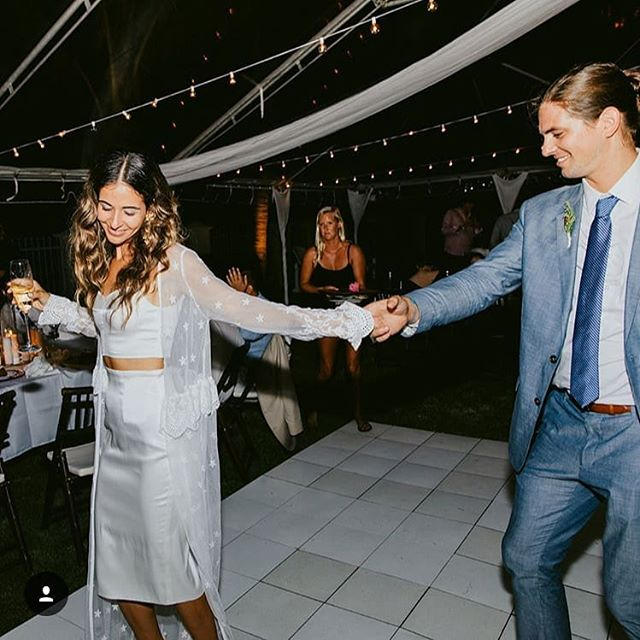 Our super chic bride @hi_soy_gabby and her handsome new hubs partying the night away in her second look which is a two piece look from Ready by @rebeccaschoneveld_bridal  We have these really playful and affordable mix and match options that are IN STOCK and ready to take home with you! All looks are priced well under $1000 and are perfect for your reception, an elopement, rehearsal, even shower!