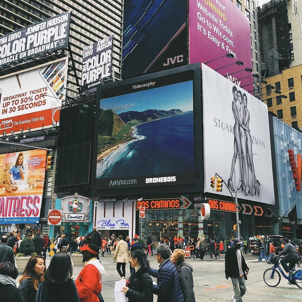 DRONEBOIS x AirVuz advertisement located in Time Square. (Photo via @nickbrownio / @ally_suhre)