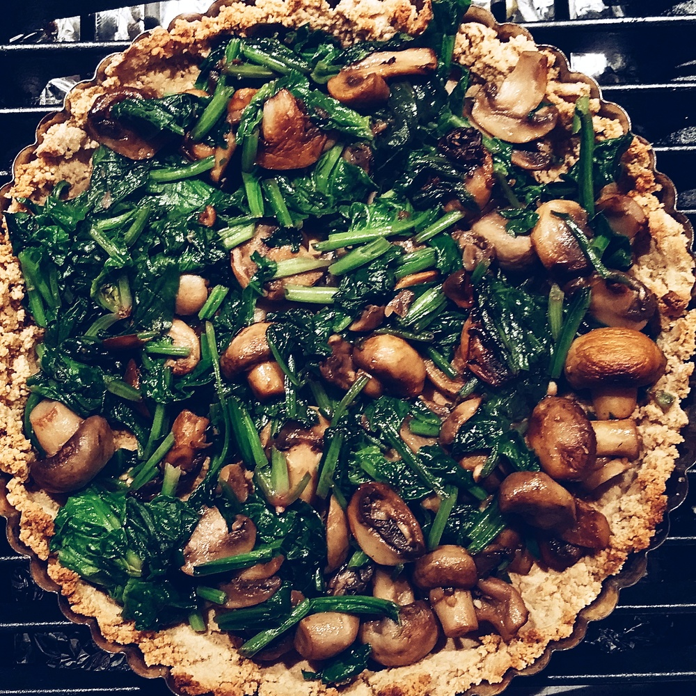Spinach & mushroom filling on top of a walnut, olive oil pastry base, waiting for its silken tofu and flaxseed topping, to make a very yummy quiche.