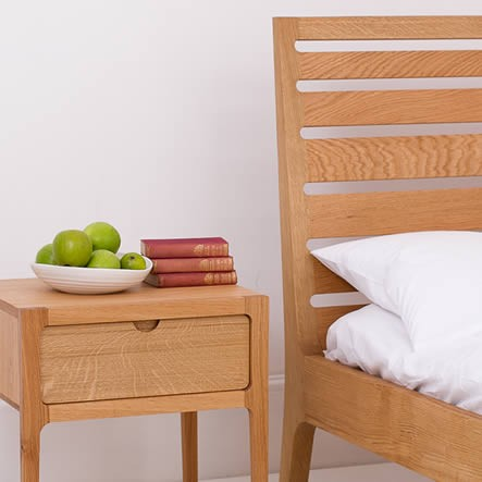 Oak bed and bedside table made in England