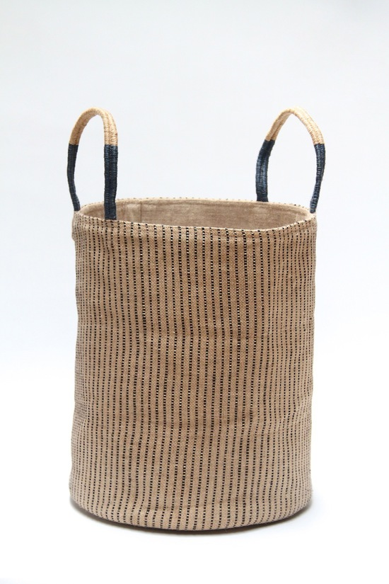 Pack your picnic in style in a fair-trade Loomed Basket with navy stripes. Jute exterior, laminated hessian on the inside and a middle layer of recycled rubber so they stand up by themselves. The exterior jute fabric is handwoven on wooden looms by women on the verandahs of their homes in a small Fair Trade artisan village in Bangladesh.