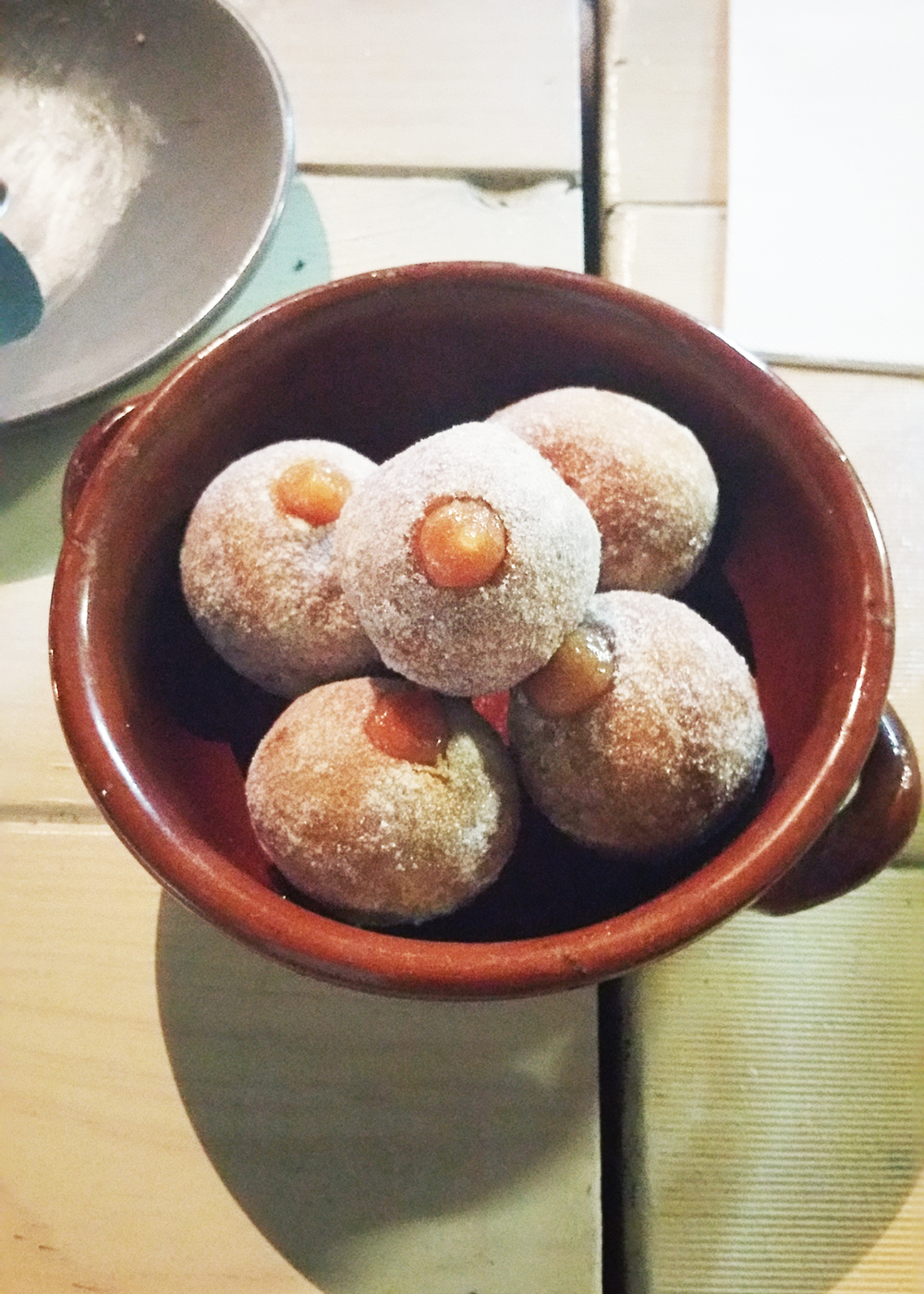 Warm Spanish doughnuts : filled with quince & dusted in spiced sugar.