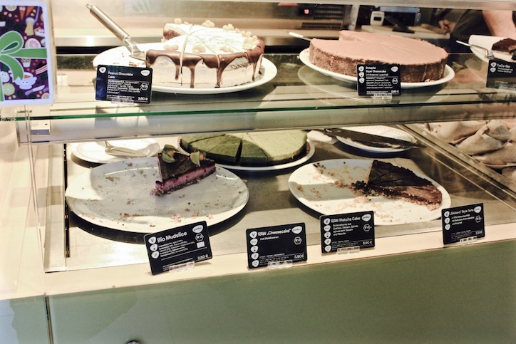 Cabinet full of vegan cakes at Goodies