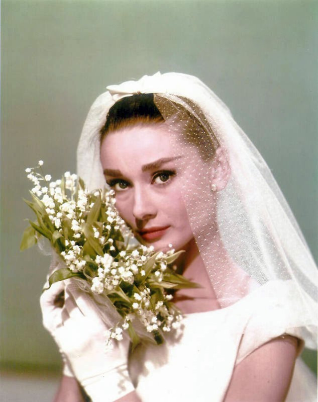 SCENTED CHARM - Audrey Hepburn carriedLily of the Valley as a bridal bouquet in the film Funny Face. The simple flowers suited her striking beauty.