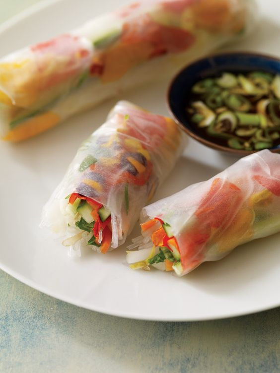 Summer rolls - rice paper rolls filled with marigold petals and crunchy fresh veggies
