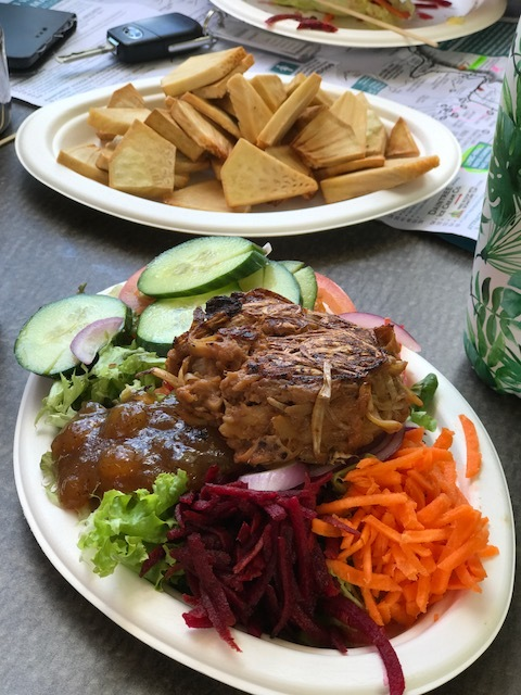 Jackfruit burger salad plate and breadfruit chips (from produce grown on their farm).