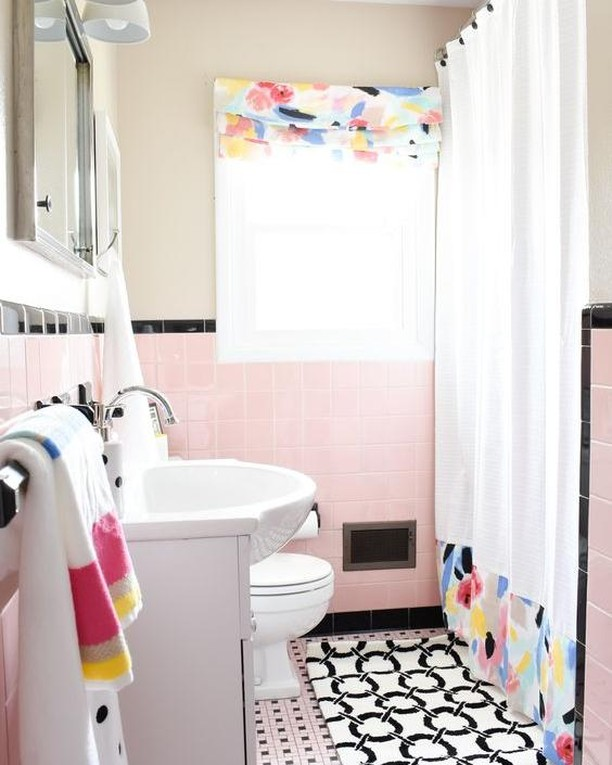 Paint + new vanity, mirror and light + stylish linens = blissful bathroom remodel on a budget. Find out more at http://tmoorehome.com  #bathroomremodel #budgetremodel