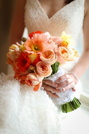 Sumptuous bridal bouquet in a timeless array of coral and peach hues. Divine!