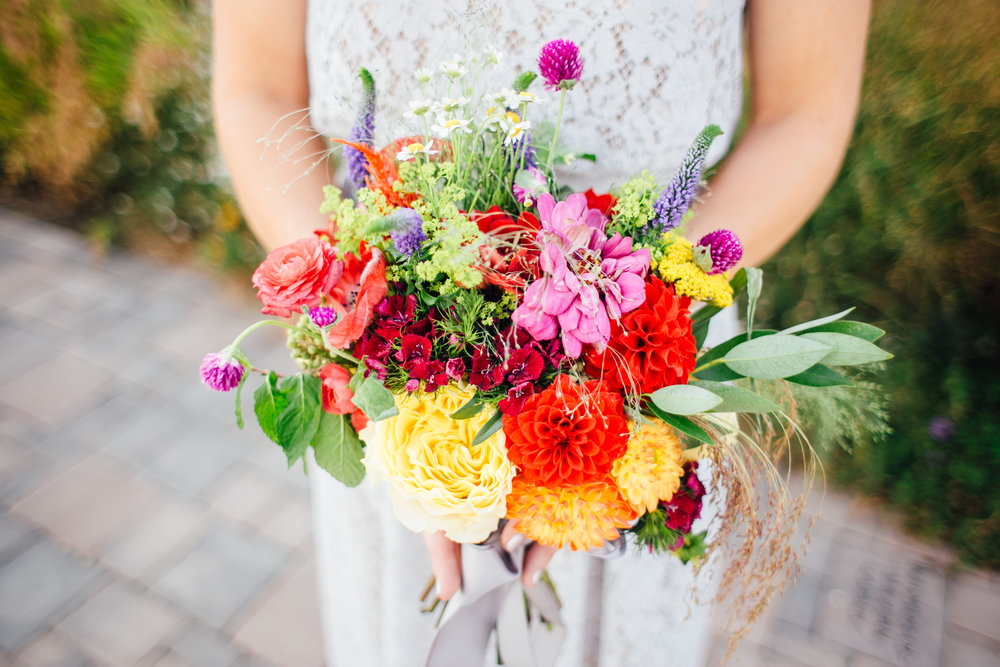 Bridesmaid's Bright Wedding Bouquet  Little Thompson Valley Pioneer Museum Berthoud Colorado Wedding