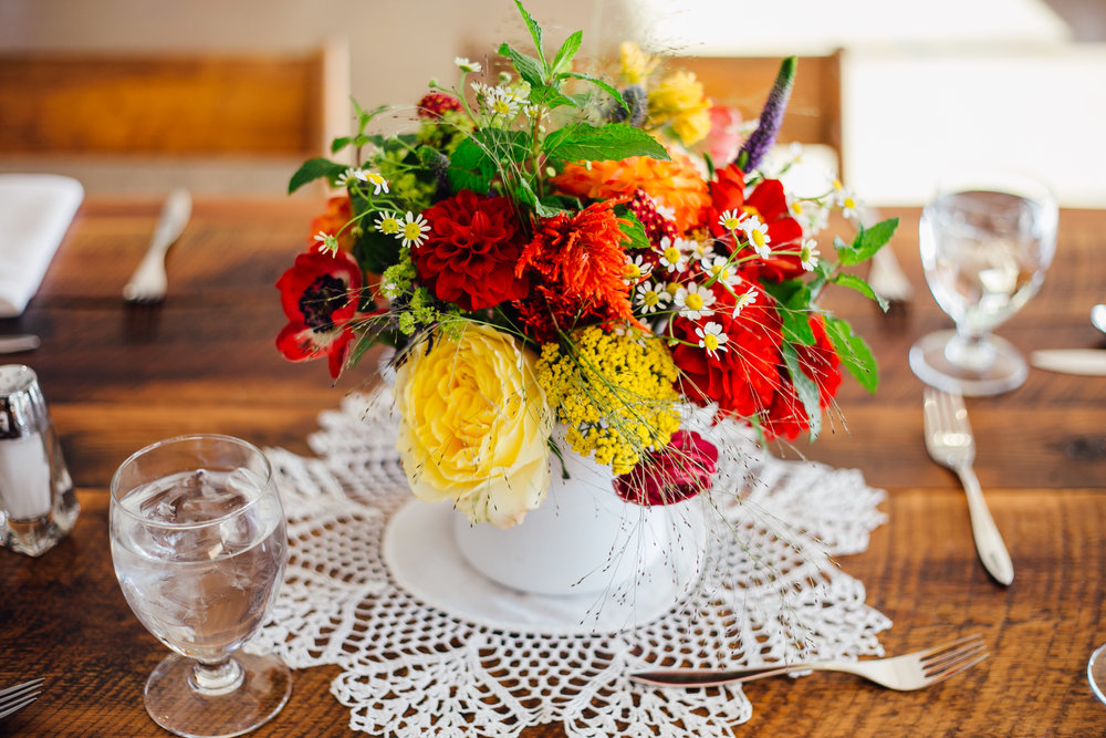 Bright Flower and Doily Centerpiece Reception Brookside Gardens Berthoud Colorado Wedding